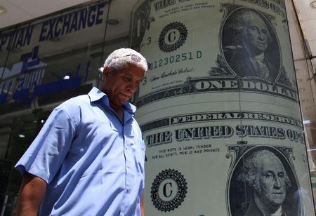 CÂMBIO-Dólar sobe ante real em pregão volátil após detalhes de proposta da Previdência