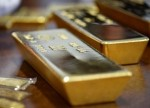 Gold hits high for the month as political worries weigh