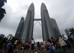 UPDATE 2-Malaysia anti-graft agents quiz ex-PM as government tots up ballooning debt