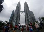UPDATE 1-Malaysia's anti-graft agents take ex-PM's statement, meet whistleblower