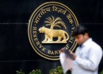 UPDATE 1-India's cenbank eases bank lending limits to some non-banking finance firms