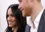 UPDATE 1-Prince Harry and Meghan visit Nelson Mandela tribute in London