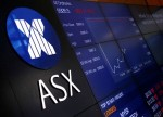 Aussie shares cheered by BHP's record annual iron ore output; NZ down