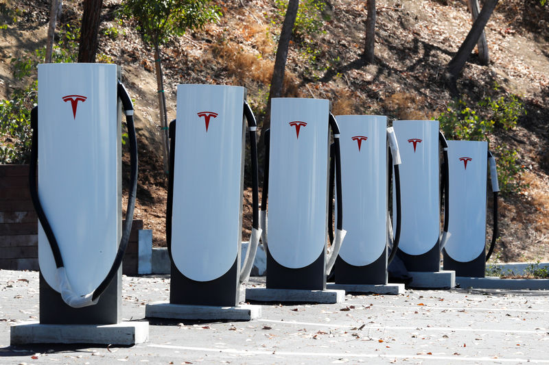Tesla Shares Down After Analyst Warns of European Competition, Walmart Sues