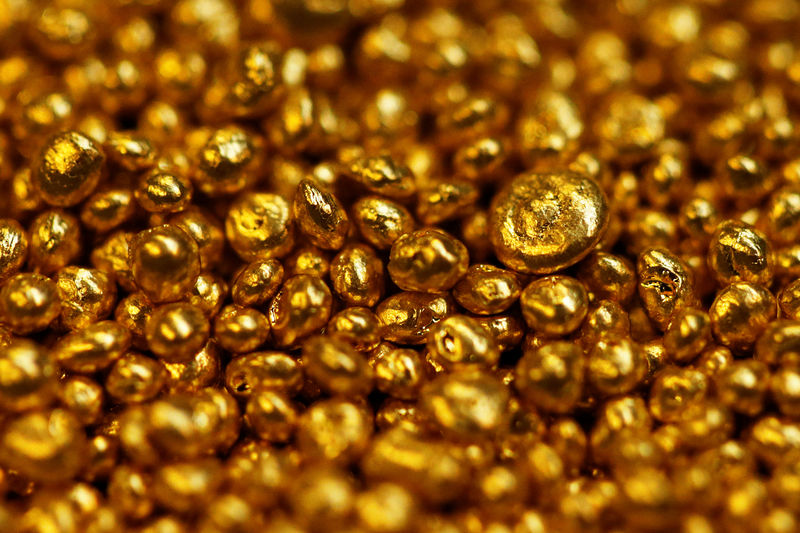 PRECIOUS-Gold prices hold steady as dollar eases