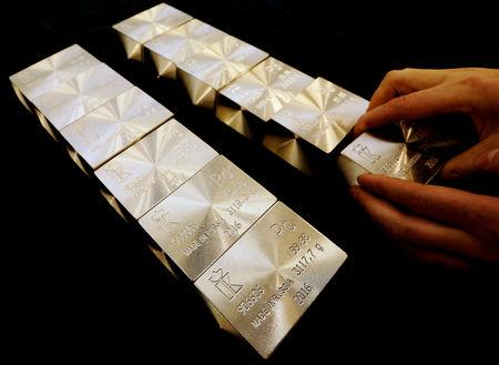 PRECIOUS-Deficit-stricken palladium soars in record run; gold eyes weekly gain