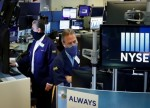 Dow Tops 34,000 as Bulls Feast on Earnings, Retail Sales
