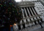 US STOCKS-Wall St set to open near record highs after Trump signs fiscal aid bill