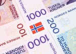 Norwegian crown up 1 pct vs euro, dollar after cbank view