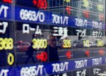 Asia stocks mixed; Sydney shares jump 1% on RBA rate cut