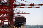 Japan current account surplus shrinks to smallest in 2014