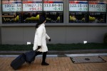 Asia shares, euro on edge as political worries mount in U.S., France