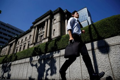 BOJ seen holding fire as protectionism overshadows signs of recovery