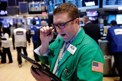 Wall Street down; lawmakers delay vote on Trump healthcare bill