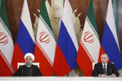 Russia and Iran say will continue efforts to curb oil output