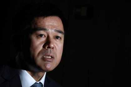 BOJ's Sato says labor reform must accompany monetary easing