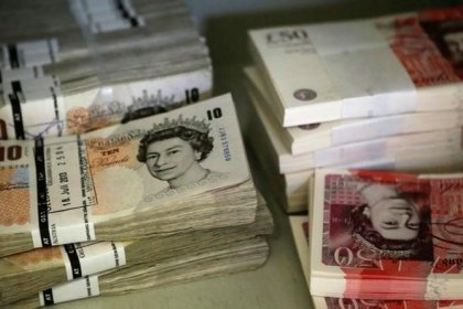 Sterling climbs, shares fall, after Brexit formally triggered
