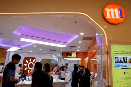 China Mobile, others approached for buying into Singapore telco M1: sources