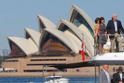 Pence tries hand at koala diplomacy Down Under