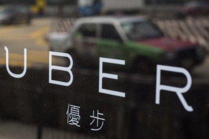 Hong Kong police arrest 21 Uber drivers
