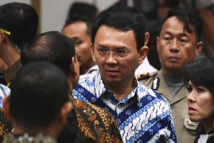 Jakarta's former governor to drop appeal against jail term