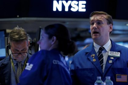 Wall St. ends little changed ahead of holiday