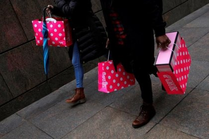 Consumer spending rises; monthly inflation rebounds