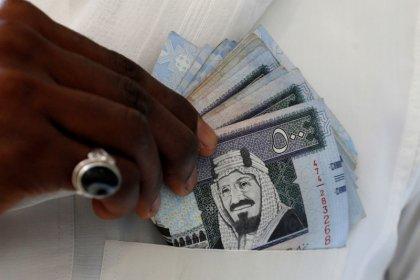 Qatar debt rating downgraded by S&P as riyal hits 11-year low