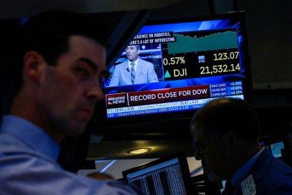 Dow sets record-high close; Fed signals gradual rate hikes