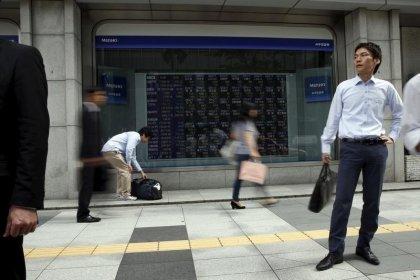 Asia stocks hit near-decade high, yen slips as BOJ cuts inflation forecast