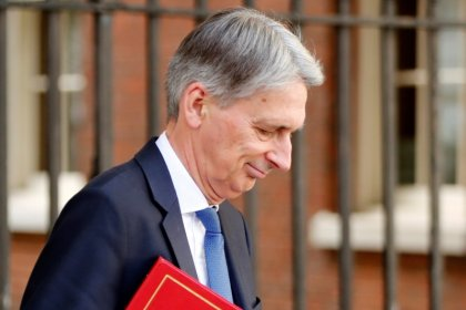 Inflation hits UK public finances in June, adding to Hammond's headache