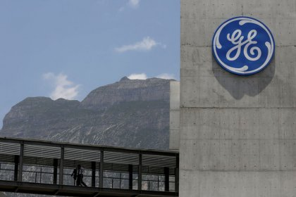 GE shares fall as profit slumps, investors await new CEO's targets
