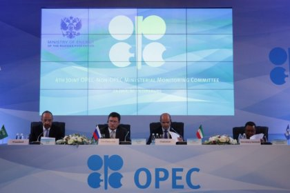 Saudi calls OPEC members to stick to limits, sees oil demand up