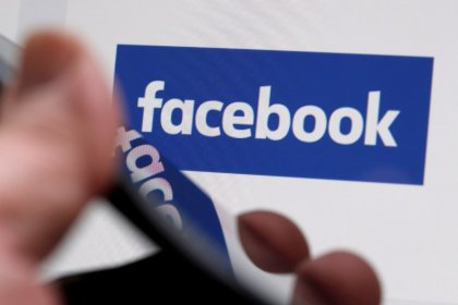 Facebook shares hit record high as mobile ad sales soar