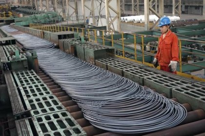 China industrial profits jump most in three months, weather higher financing costs