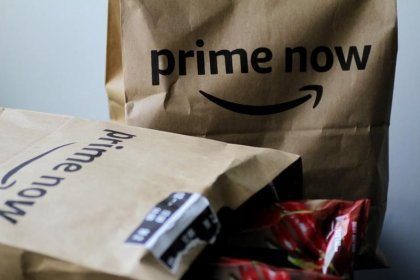 Amazon plows ahead with high sales and spending; profit plunges