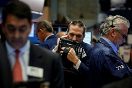 Stocks rise on earnings; yields up as monetary policy in focus
