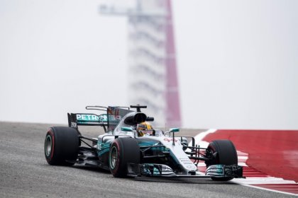 Motor racing-Hamilton smashes track record in Austin