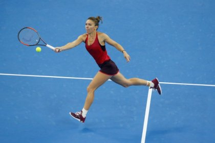 Top-ranked Halep hoping to keep dream alive at WTA Finals