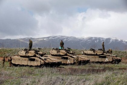 Israel says it will intensify response to Syrian fire