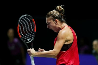 Halep too strong for Garcia in Singapore opener
