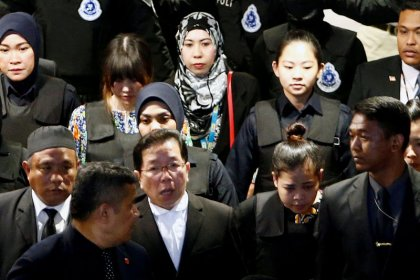 Chaotic scenes as suspects wheeled around airport where North Korean leader's brother killed