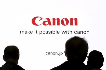 Canon hikes profit outlook on demand for surveillance cameras, OLED production gear