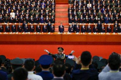 China enshrines 'Xi Jinping Thought', key Xi ally to step down