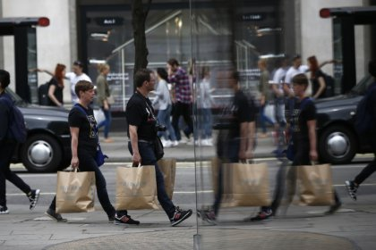 Britain's shoppers rein in spending, first yearly decline since 2013