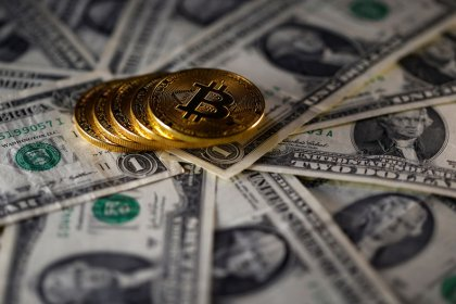 Fork talk lifts bitcoin to all-time high near $8,000