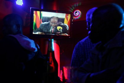 Mugabe defies demands to quit as Zimbabwe's leader after party fires him