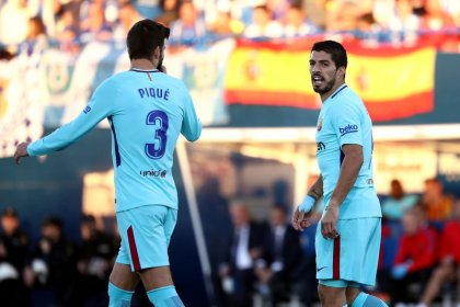 Barcelona to appeal Suarez, Pique yellow cards