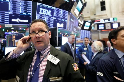 World stocks at record high after Fed hike; dollar falls