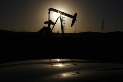 Rising U.S. output weighs on oil prices